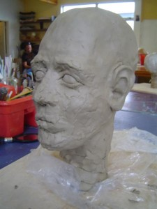 Putting on the facial features, stage 3, side view.