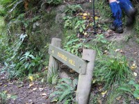 Start of Honeycomb steep climb from Careys Creek at Double Hill route sign. Bill's gaiters.