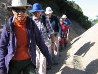 Traversing gut between gravel and bank. Marie from Toronto, Lex, Bill, Ria, Hazel