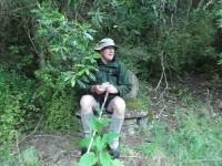 3. Ken taking advantage of the stone seat (Ken caption)