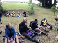 Panorama of some of the 26 hikers lunching.