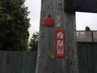 Red ticketed power pole. (Ian pic and caption.)